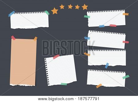 Ripped white, brown note, notebook, copybook, ruled paper strips stuck with colorful sticky tape, stars on black background