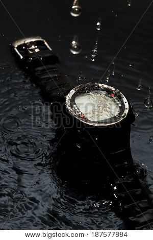 Watches for scuba diving in streams of water on a black background, studio light