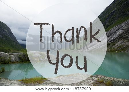 English Text Thank You. Lake With Mountains In Norway. Cloudy Sky. Peaceful Scenery, Landscape With Rocks And Grass. Greeting Card