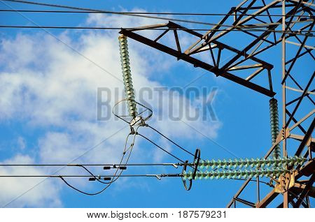 High voltage. Transmission line Insulators. Blue sky background.
