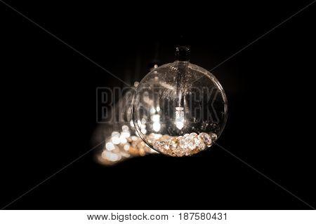 Shinning Light Bulb Lights in Dark Room