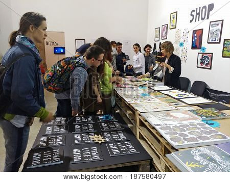 KIEV - UKRAINE - MAY 2017:  Art and book exhibition in Arsenal museum in Kiev. Visitors to the exhibition inspect the goods.