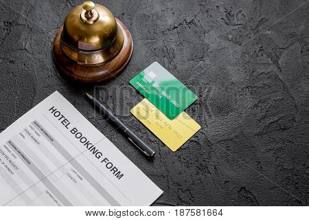 booking hotel room application form and ring on dark desk background mock up