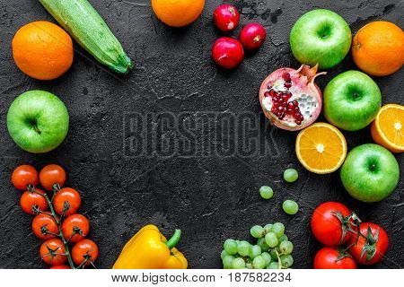 fresh vegetables and fruits for fitness dinner on dark desk background top view mockup