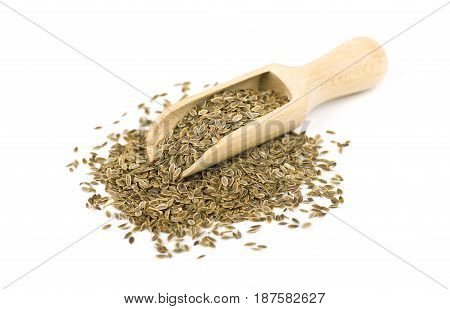 Heap dill seed on the spoon, isolated on white background