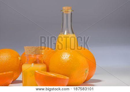 Beautiful fresh oranges and utensils, on white background