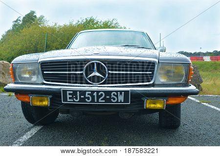 LE MANS, FRANCE - APRIL 30, 2017: Black Mercedes Benz logo close up Vintage model