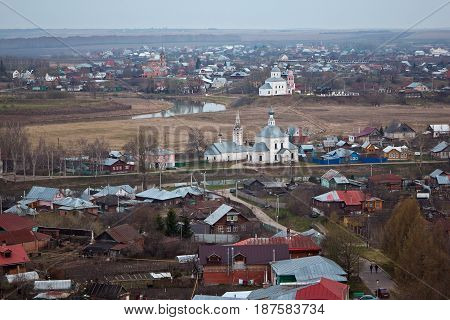 Evening old Suzdal cityscape from rooftop. Churches, monasteries and old houses