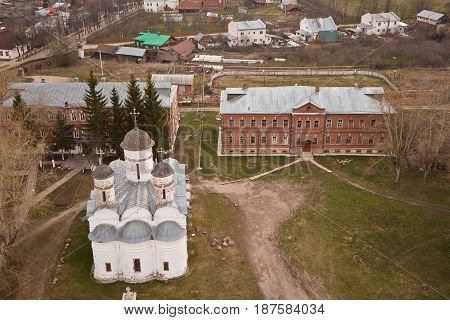 Evening old Suzdal cityscape from rooftop. Wall of Rizopolozhensky monastery