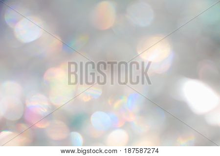 Silver and rainbow light color bokeh modern blurred background