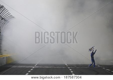 May 20, 2017 - Concord, NC, USA: Kyle Busch (18) does a burnout for the fans after winning the Monster Energy NASCAR All-Star Race at Charlotte Motor Speedway in Concord, NC.