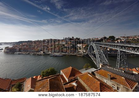 PORTO, PORTUGAL - MAY 8, 2017: Dom Luis I Bridge across river Douro. This double-deck metal arch bridge was built in 1881-1886
