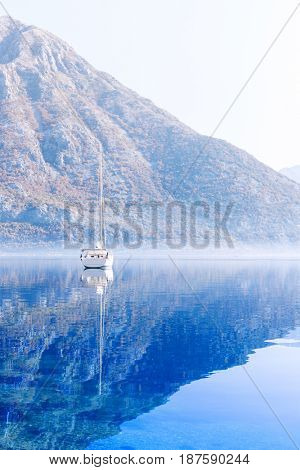 Harbour and boats in sunny day at Boka Kotor bay, Montenegro.
