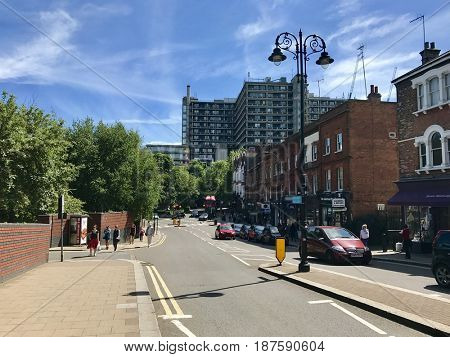 LONDON - 2 MAY, 2017: The Royal Free Hospital visible from the high street at Hampstead Heath Overground station in South End Green, Hampstead, North London, UK.