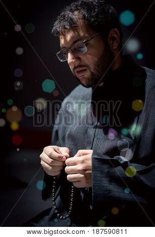 Muslim Arabic man praying in Ramadan