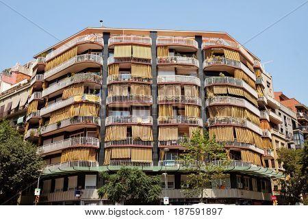 BARCELONA - JULY 29, 2016: Mid-twentieth century apartment block on a corner in the Gothic Quarter