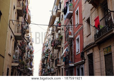 BARCELONA - JULY 29, 2016: View down a densely populated narrow residential street