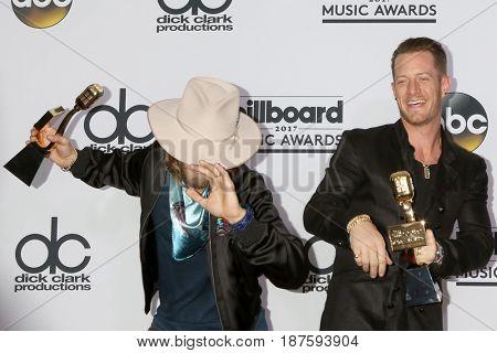 LAS VEGAS - MAY 21:  Florida Georgia Line, Brian Kelley, Tyler Hubbard at the 2017 Billboard Awards Press Room at the T-Mobile Arena on May 21, 2017 in Las Vegas, NV