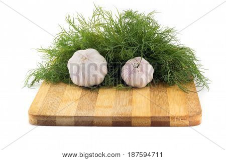Still Life Of Garlic On A Wooden Board With Dill On White Background