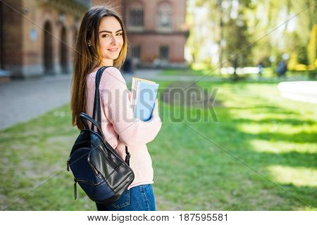 University Student Smiling With Coffee And Book Bag On Campus With Print Space