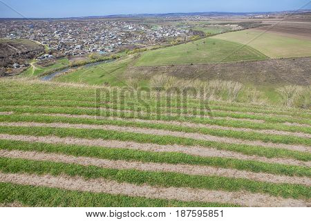 landscape with village situated between hills in Moldova