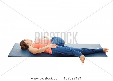 Woman doing Yoga asana Parivrtta ardha pawanmuktasana - Revolved knee-to-chest Pose back stretch isolated on white background