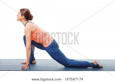 Woman doing yoga asana Anjaneyasana - low crescent lunge pose in Surya Namaskar Sun Salutation isolated on white background