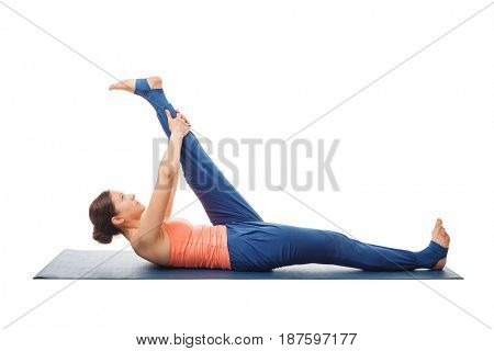 Woman doing Yoga asana Supta padangusthasana - reclining hand-to-big-toe pose isolated on white background