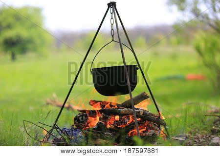 Smoked tourist kettle over campfire