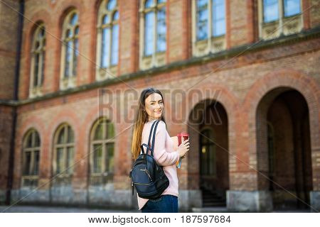 Smart Intelligent Grad Student Glasses Confident Happy At University Garden With Bag And Books Drink