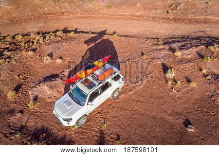 POTASH , UT, USA - MAY 7, 2017:  Toyota 4runner SUV (2016 trail edition) with a kayak and recovery tracks on roof on a desert trail in the Moab area - aerial view