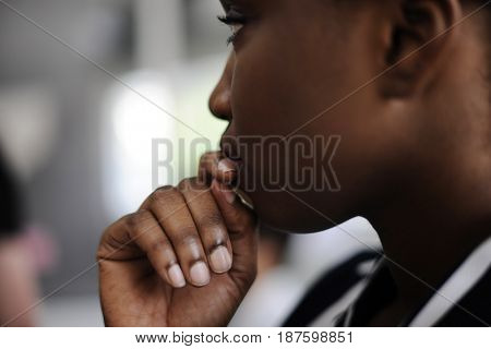 Close up candid shot of black woman thinking