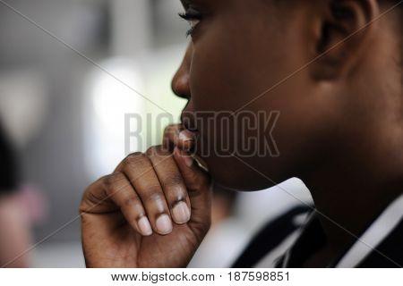 Close up candid shot of black woman thinking