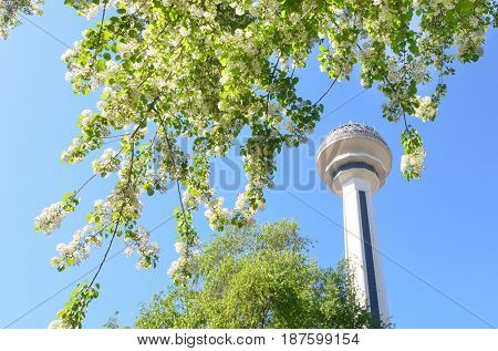 ANKARA, TURKEY - APRIL 28, 2017: Atakule and spring blossoms. Atakule is one one of the primary landmarks of Ankara.