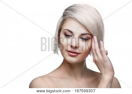 beautiful young blond woman with brown eyes against  white background
