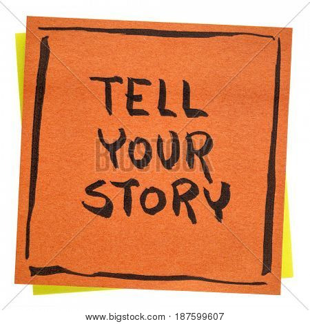 Tell your story inspirational  advice - handwriting on an isolated sticky note