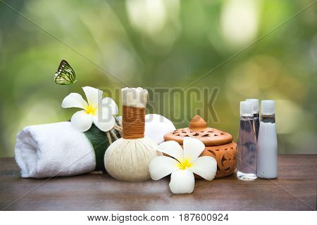 Spa massage compress balls herbal ball and treatment spa Thailand background green nature