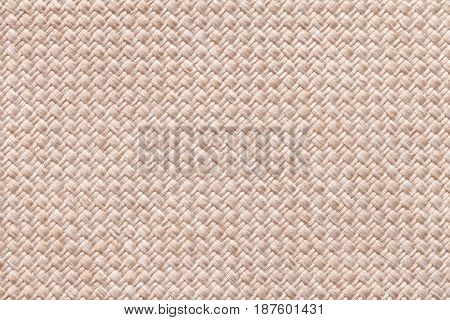 Light pearl woolen background of dense woven bagging fabric closeup. Structure of the cream cloth with natural texture. Cloth backdrop.