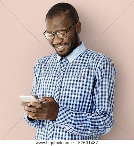 African Descent Guy is Smiling with Smartphone