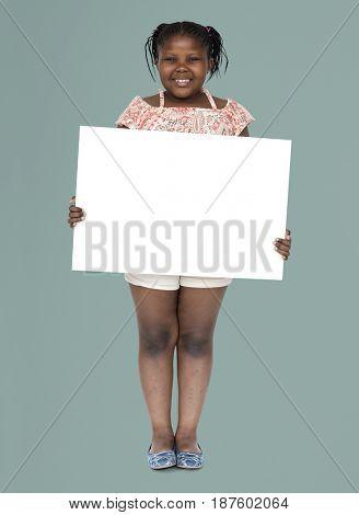 Little african girl holding blank banner
