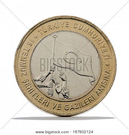 New Turkish Lira coin for remembering the martyrs of 15 July's attempted coup isolated on white background.