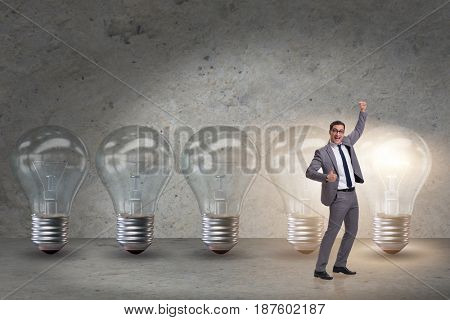Businessman in new idea concept with light bulb