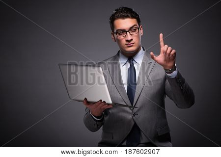 Handsome businessman working on laptop computer