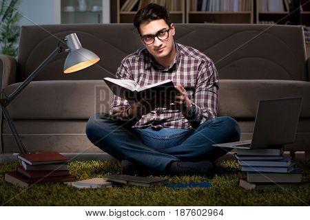 Student reading books preparing for exams