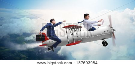 Businessman flying on vintage old airplane