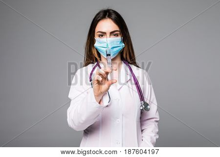 A Portrait Of A Young Female Doctor Smiling With A Syringe In Her Hand. Portrait Of A Beautiful Woma