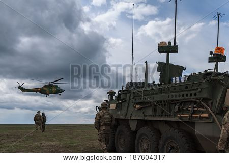 Over 2,200 servicemen of the armies of the UK, Ireland, Moldova, Romania and the USA are involved in the 'Wind Spring 15' military exercise in the Smardan range of Galati County on April 22, 2015.