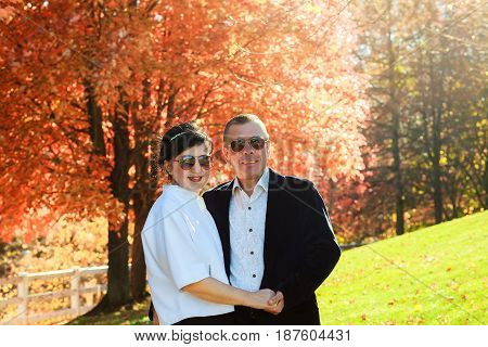 Beautiful portrait of happy young couple in love on a walk in autumn forest