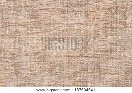 Light brown fluffy background of soft fleecy cloth. Texture of beige fuzzy textile closeup.