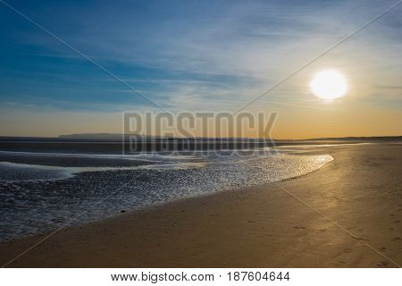 Camber Sands beach in spring at low tide at sunset, East Sussex, England, U.K